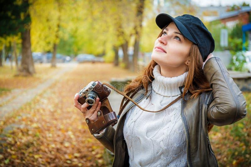 Girl with a camera walks. royalty free stock photos
