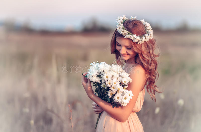 Girl in a camomile wreath. Beautiful girl in a camomile wreath royalty free stock image