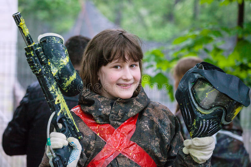 Girl in camouflage after paintball game stock images