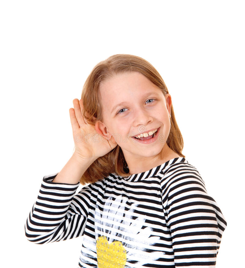 Girl can't hear. A beautiful young girl standing for white background with her hand on her ear, she can not hear stock images