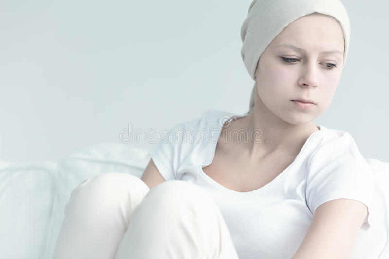 Girl with cancer looking away stock photo