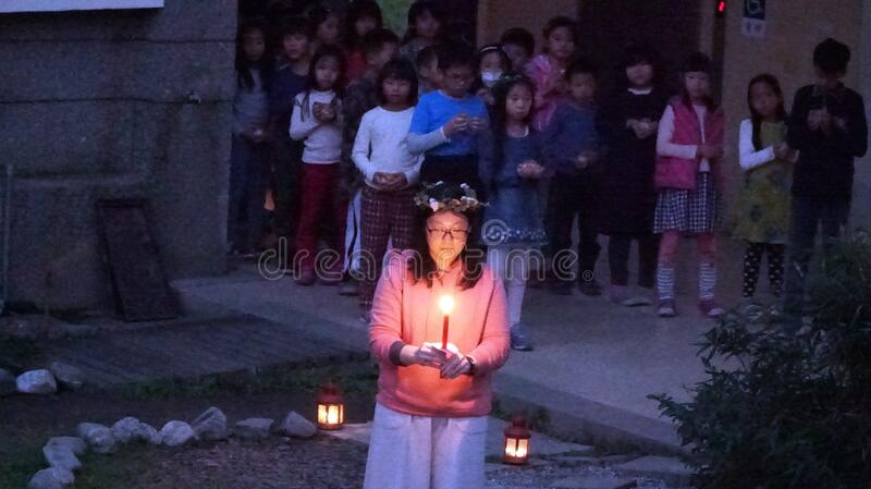 Girl with candle in ceremony royalty free stock photos