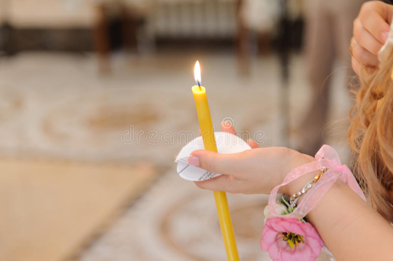 Girl with Candle. Girl with flower holding candle at church royalty free stock images