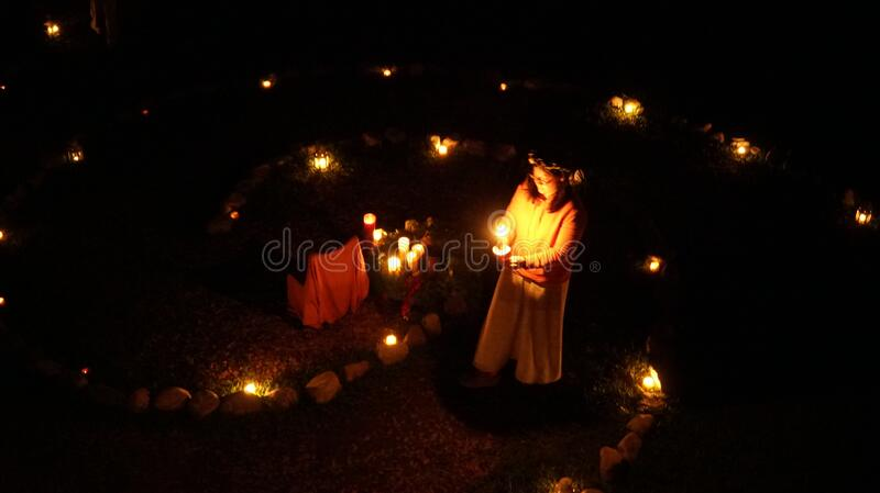 Girl with candles stock images