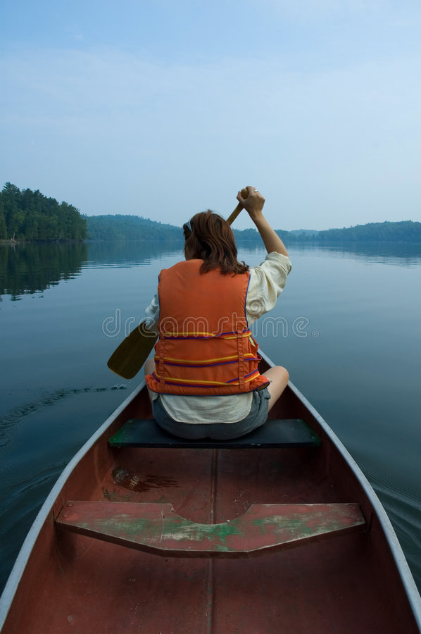 Girl in canoe. Canoe royalty free stock photo
