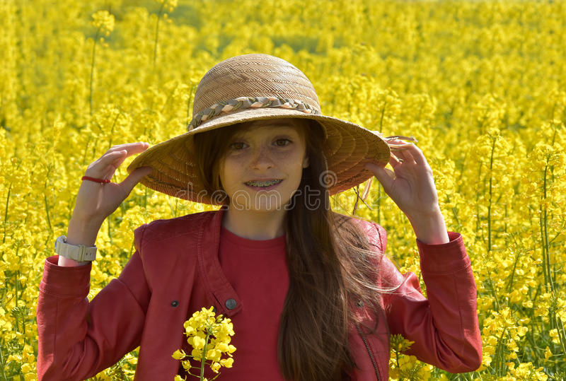 Girl in canola field royalty free stock photo