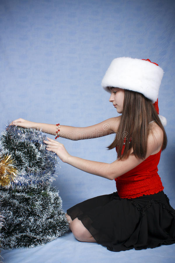 Download Girl In A Cap With The Christmas Decorations. Stock Photos - Image: 11931843