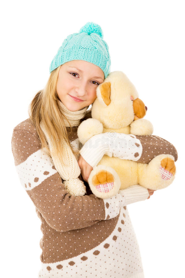 Girl In A Cap And A Toy Stock Image
