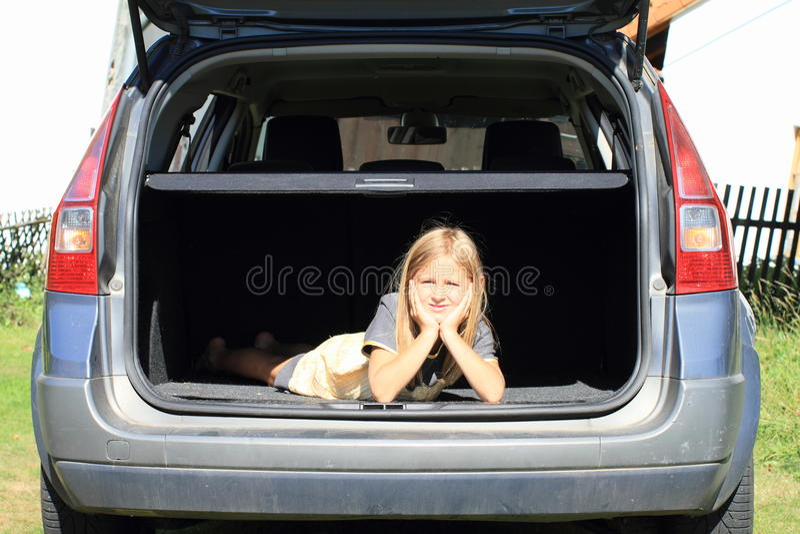 Girl In Car Trunk Royalty Free Stock Photos