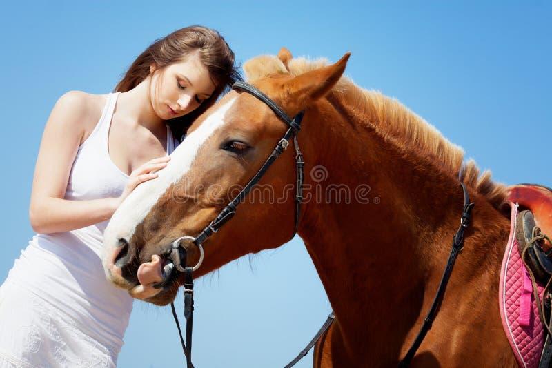 Girl caress her horse