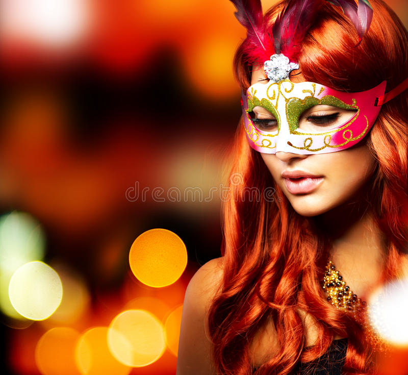 Girl in a Carnival mask. Masquerade. Beautiful Girl in a Carnival mask royalty free stock photos