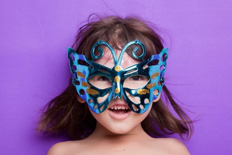 Girl in carnival mask. The girl in carnival mask stock image
