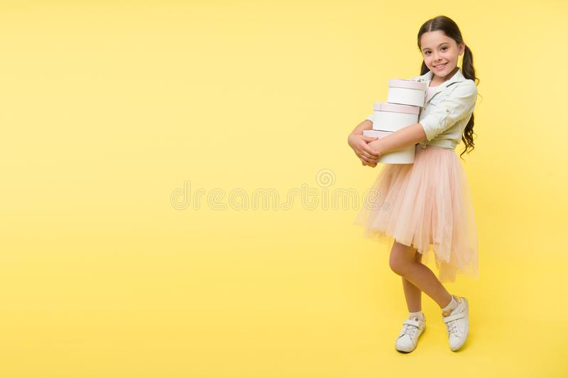 Girl carries pile boxes. Save money shopping sale season. Back to school season great time to teach budgeting basics stock image