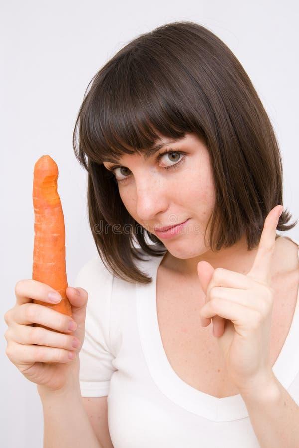 Girl with carrot stock photos