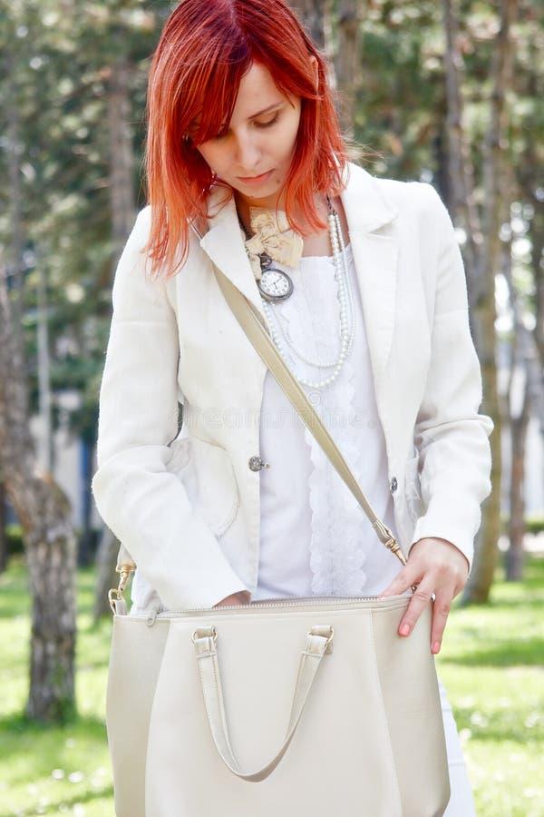 Girl carrying bag royalty free stock photos