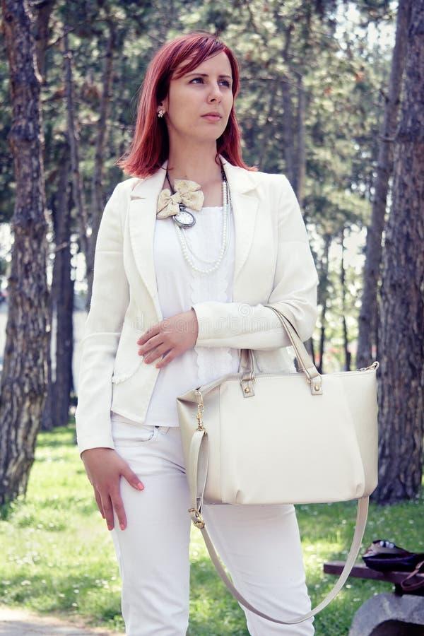 Girl carrying bag stock photography