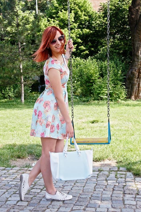 Girl carrying bag royalty free stock photo