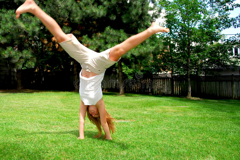 Girl cartwheel royalty free stock photos