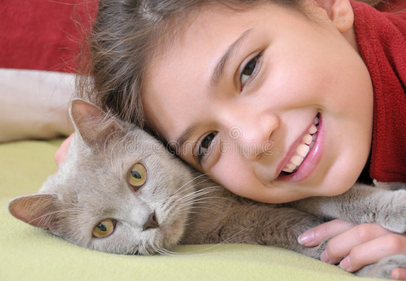 Girl with cat. Portrait of pretty girl with cat stock photo