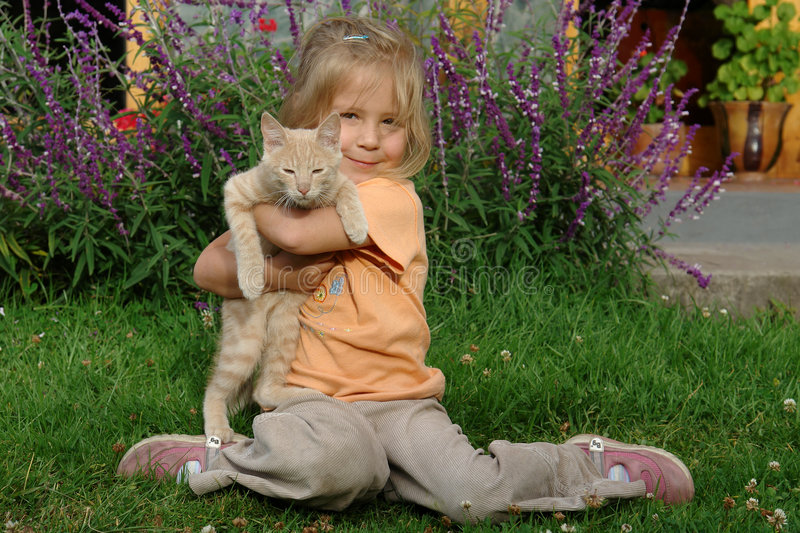 Download Girl with a cat stock photo. Image of people, bush, green - 1095704