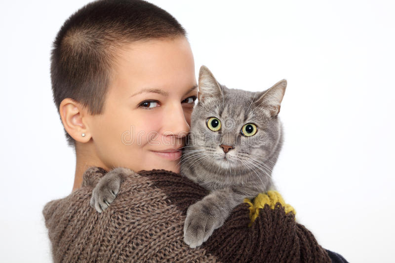 Girl and cat. Young smiling woman hold gray domestic cat royalty free stock photos