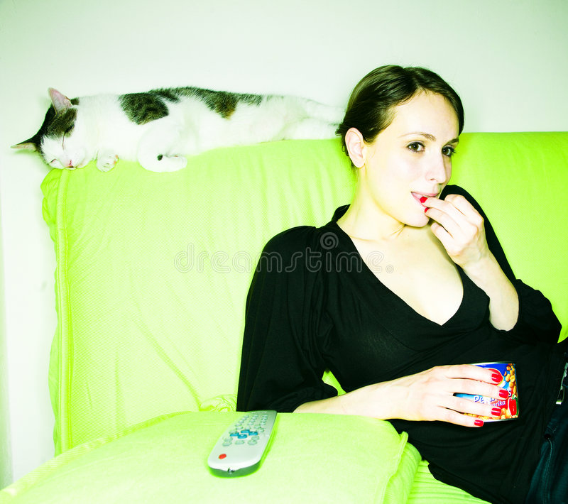 Download Girl with cat stock photo. Image of love, snack, sofa - 4881028