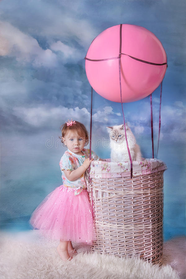 Girl and cat with balloon stock image