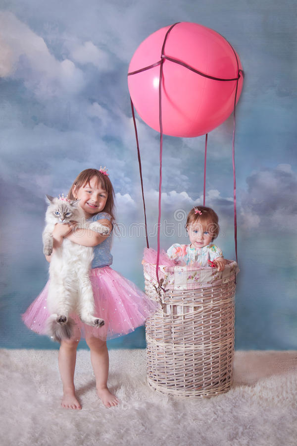 Girl and cat with balloon stock images