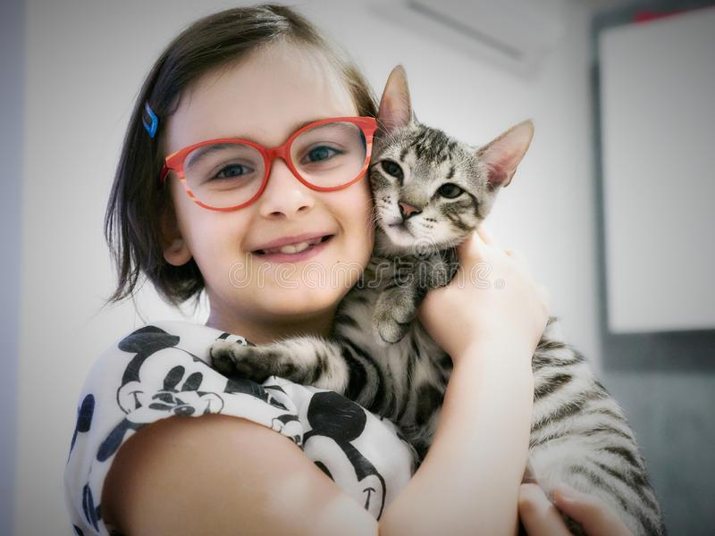 Girl with a cat in her arms stock image