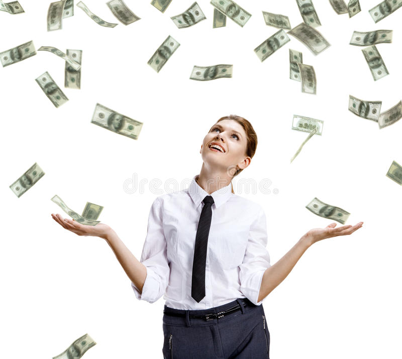 Girl catches the falling money. Stock image of money falling around happy businesswoman - isolated on white background royalty free stock photography