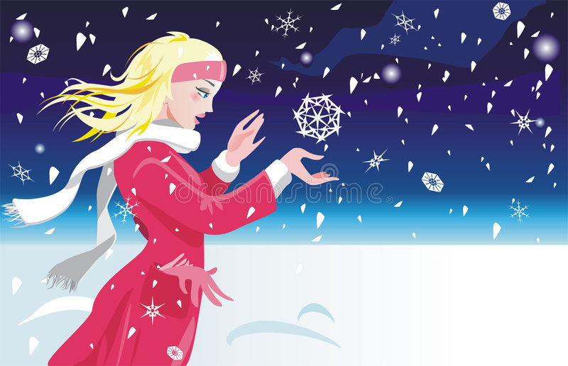 The girl catches snowflakes stock image