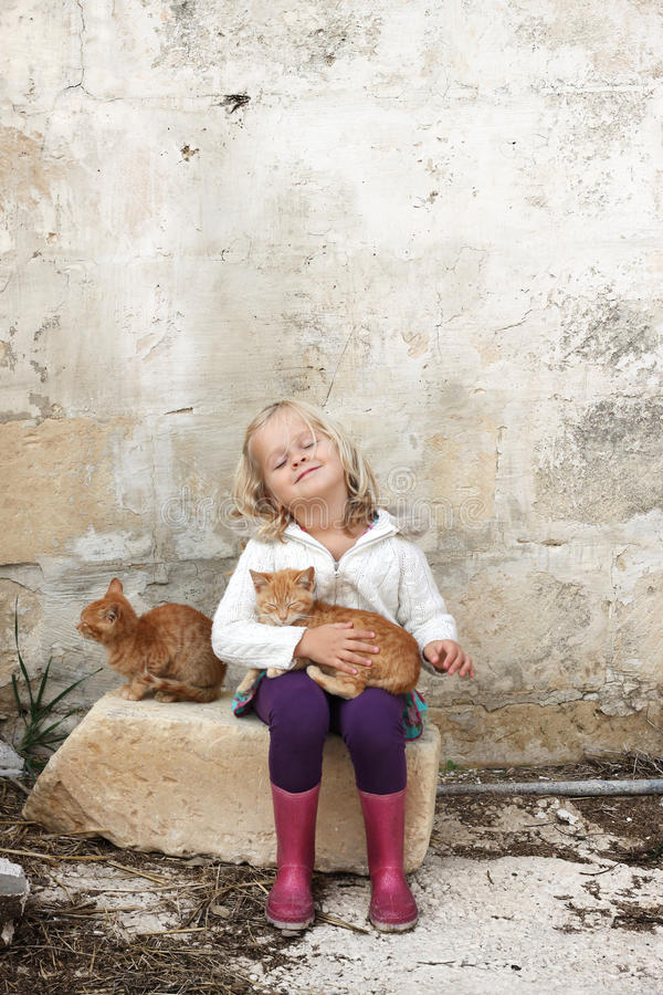Girl with cats stock photo