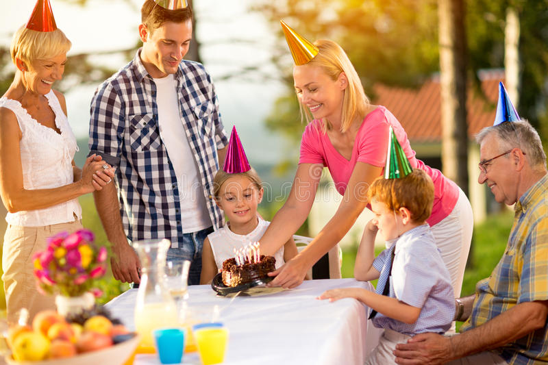 Girl celebrate happy birthday party. With family royalty free stock photography