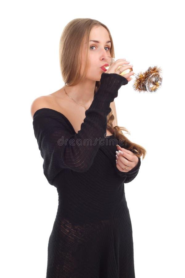 Girl celebrates Christmas with a glass of wine. Studio shooting stock photography