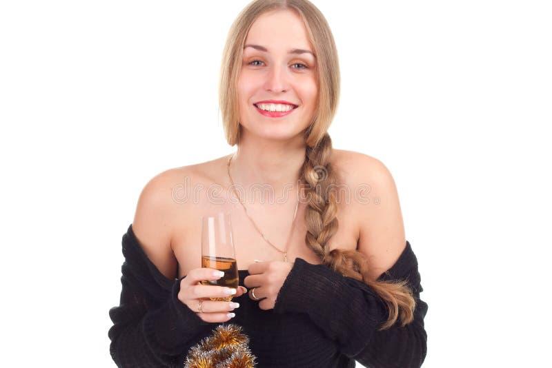 Girl celebrates Christmas with a glass of wine. Studio shooting stock photos