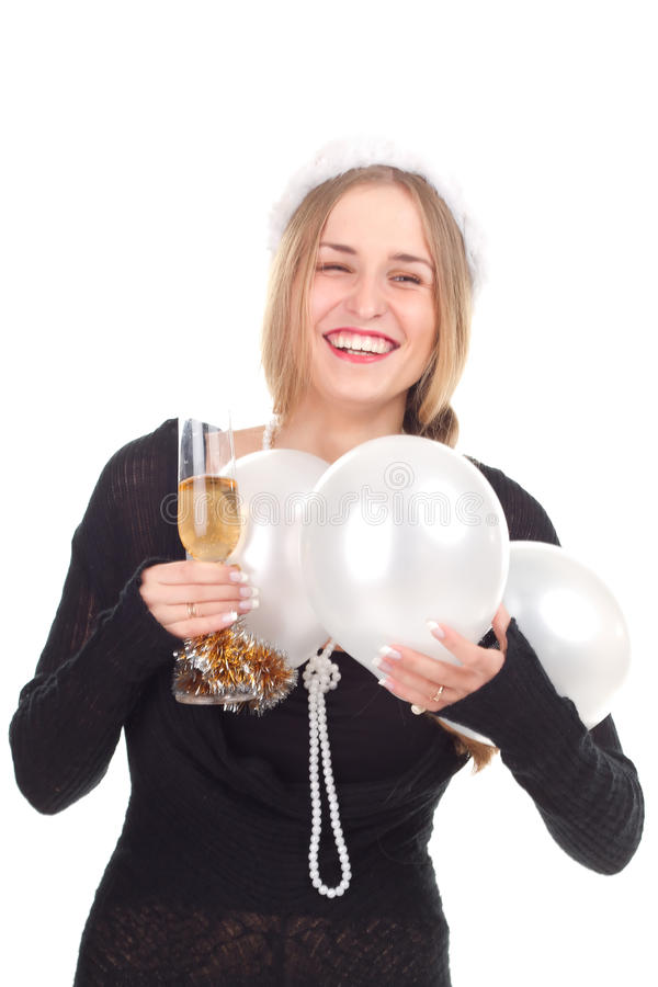 Girl celebrates Christmas with a glass of wine. Studio shooting royalty free stock images