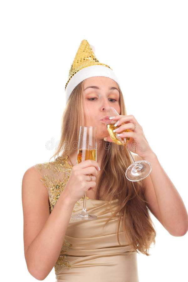 Girl celebrates Christmas with a glass of wine. Studio shooting stock image