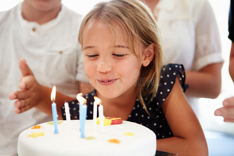 Girl Celebrating Birthday With Cake. Blowing Out Candles stock photos