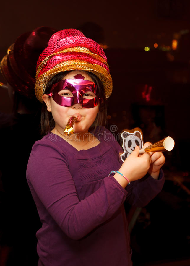 A girl celebrating New Year's Eve royalty free stock image