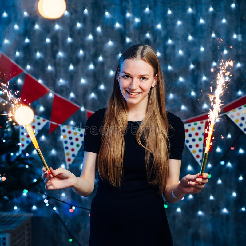 Girl celebrating new years eve with bengal light. Christmas stock photography