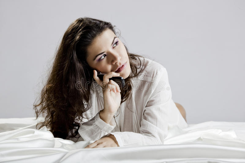 Download Girl with a cellphone stock photo. Image of lying, sensual - 15411508