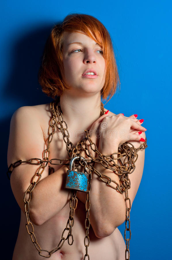 Girl with chains and padlock stock photos