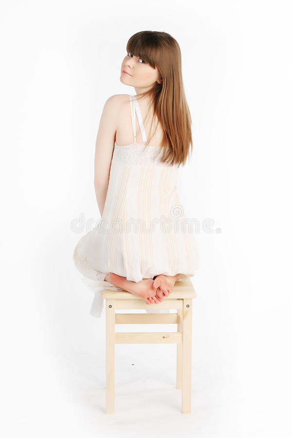 Girl on a chair royalty free stock image