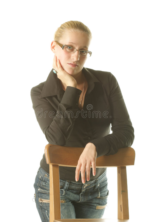 Girl at chair royalty free stock photography