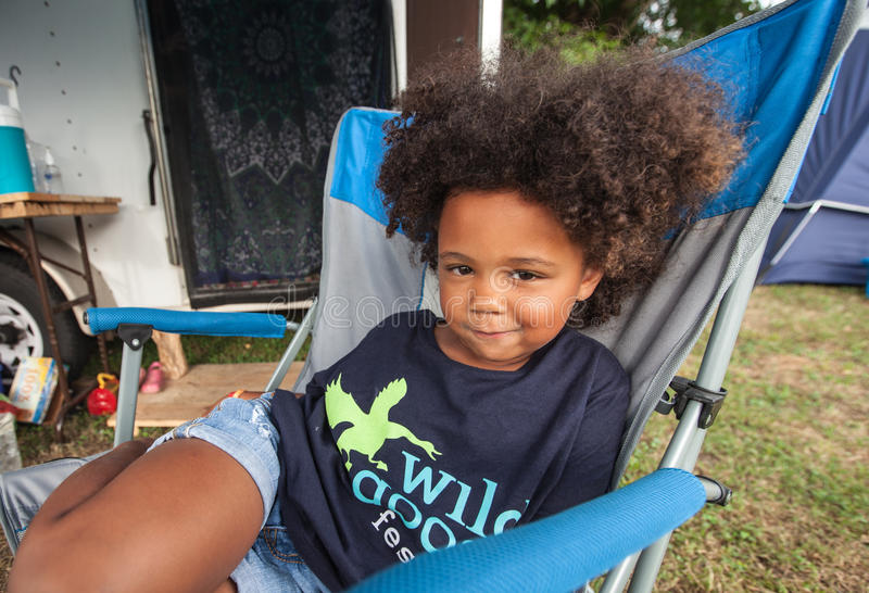 Girl in Chair at the Wild Goose Festival stock photography