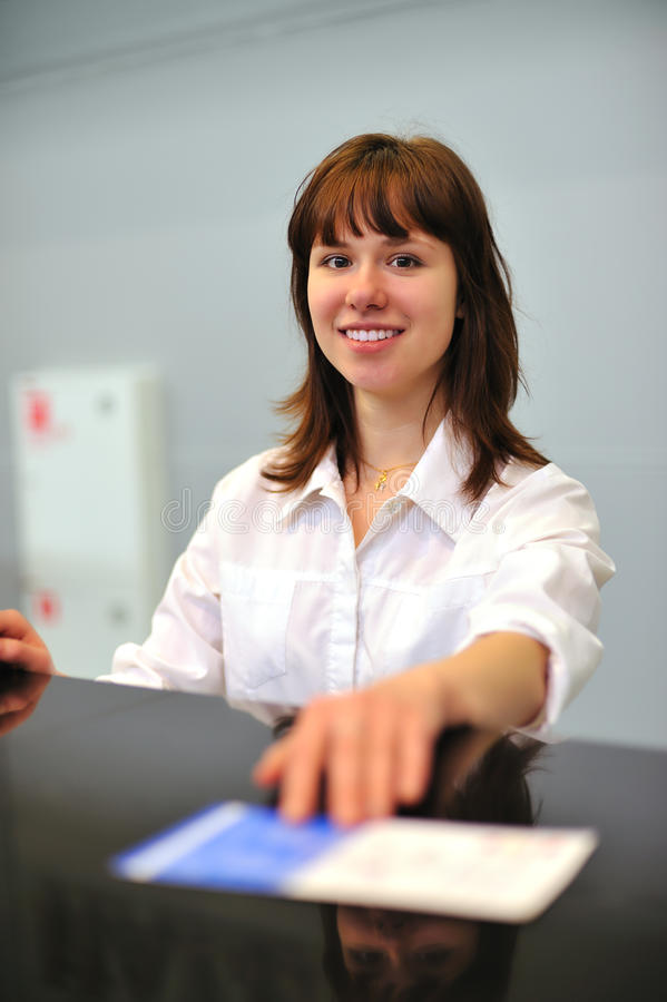 Download Girl at check-in counter stock image. Image of customer - 13696151