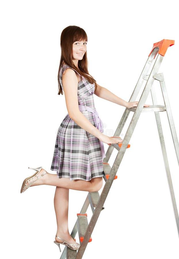 Girl in checked dress on stepladder