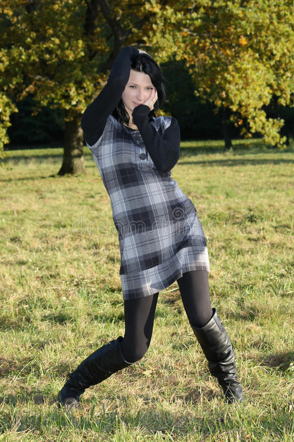 Download Girl In Checkered Dress Posing In Autumn Park Stock Photo - Image: 16437666