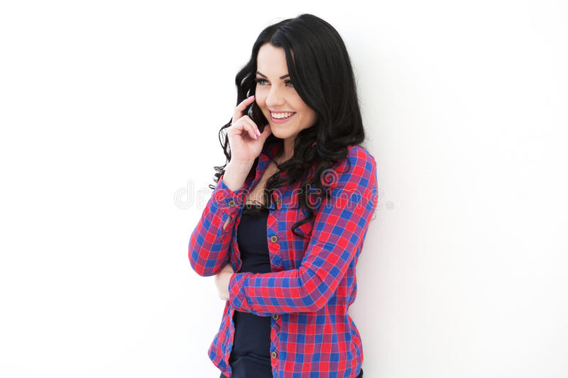 Girl in checkered shirt speaking on cellphone. royalty free stock images