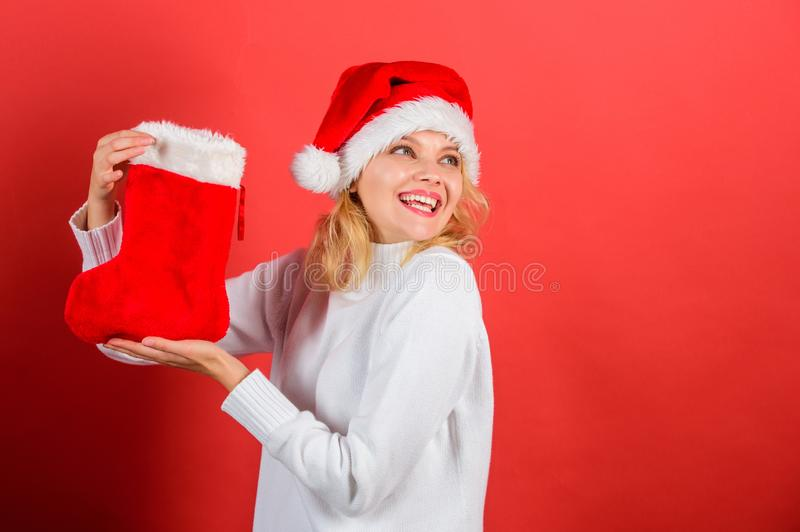 Girl cheerful face got gift in christmas sock. Christmas stocking concept. Traditional winter holiday. Check contents of. Christmas stocking. Woman in santa hat stock photos